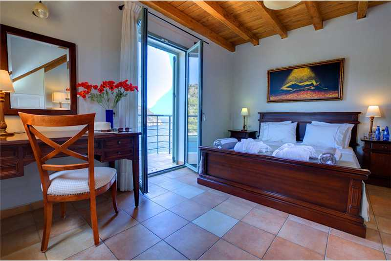 Villa Akrogiali master bedroom with doors to balcony