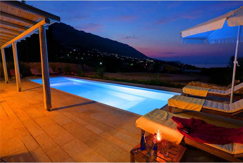 Villa Asterias pool at night