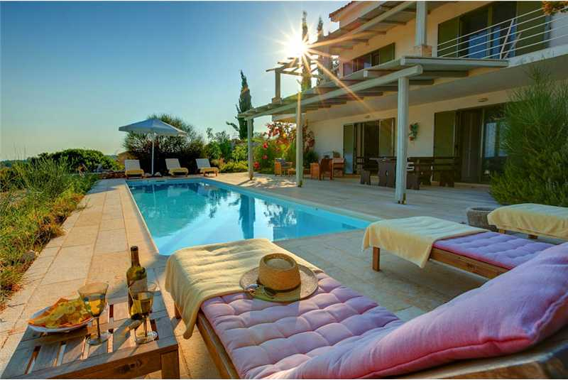 Villa Asterias relax by the pool with a glass of wine