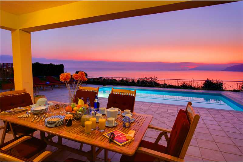 Fiscardo House dine alfresco watching the sunset over the Ionian Sea