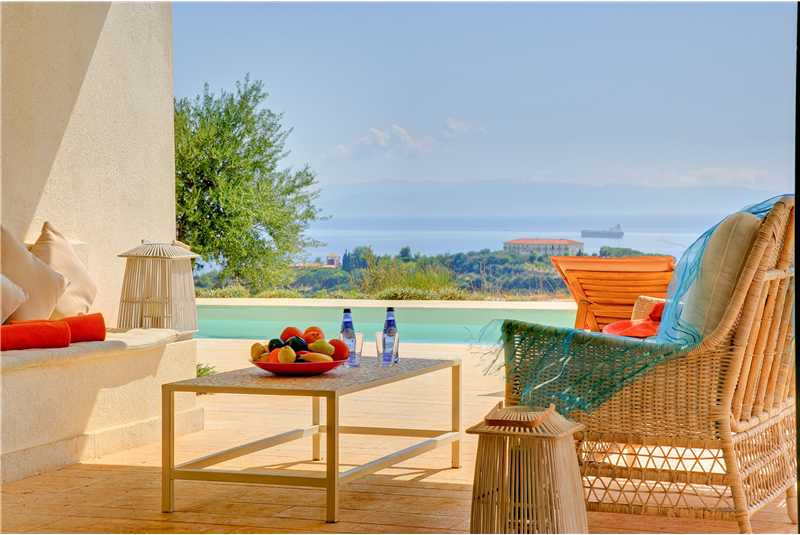 Relax under the shaded terrace with stunning views of the ionian sea