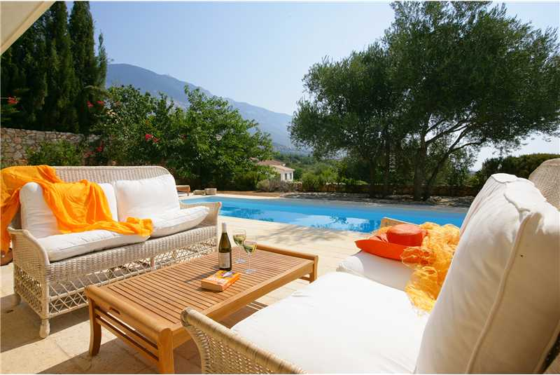 Villa Telina wicker chairs by the pool